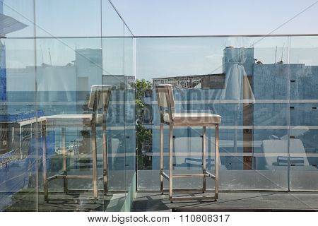 stainless steel on sunny terrace with bay view and decoration in contemporary home