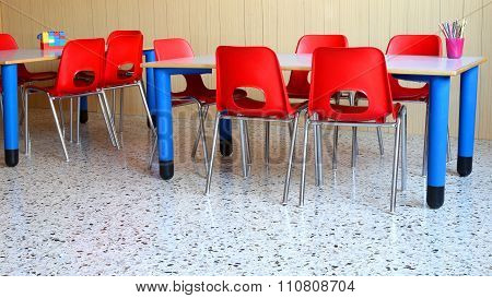 Nursery Classroom With The  School Desks And Chairs