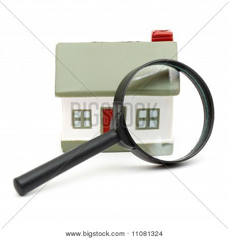 A magnifying glass examining model home