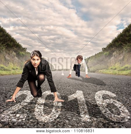 man versus woman on a road with year 2016 painted on it