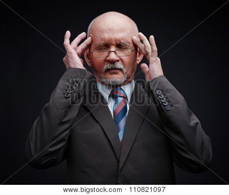Mature businessman trying to remember something