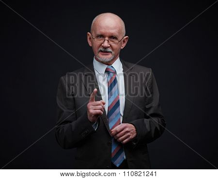Mature businessman in formal-wear telling something in isolation