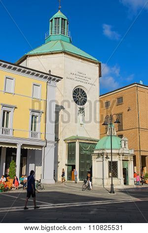 Tourists Walking Near The Ancient Paolotti Church (chiesa Dei Minimi Di Paola) In Rimini, Italy