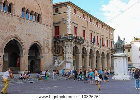 Tourists Walking Near Rimini City Hall And Statue Of Pope Paul V On Cavour Square In Rimini, Italy