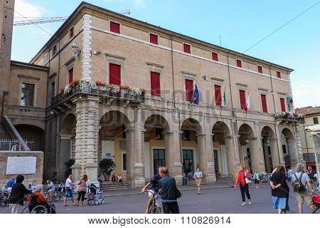 Tourists Walking Near Rimini City Hall On Cavour Square In Rimini, Italy