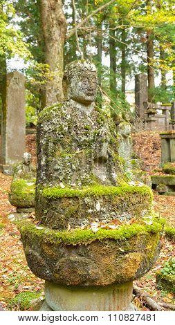 Old stone image of Buddha