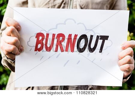 Woman Is Holding A Paper With Word Burnout