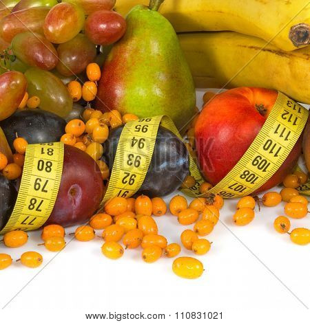 Different Fruits And Centimeters Closeup