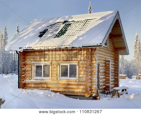New Wooden Russian Sauna On A Sunny Winter Day, The View From The Outside, Against The Backdrop Of S