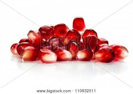 Close-up image of pomegranate seeds on white background