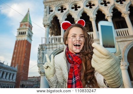 Woman Taking Christmas Selfie And Showing Victory In Venice