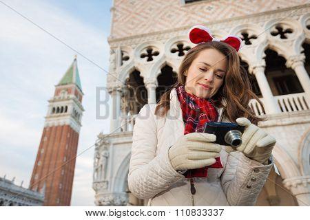 Woman Tourist Checking Photos While On Christmas Venice