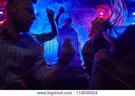 Disc jockey at the turntable in nightclub