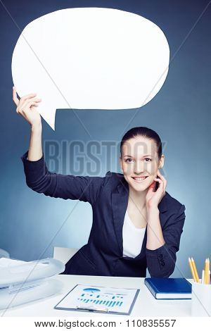 Smiling businesswoman holding white sigh over her head