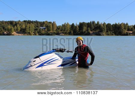 Young man near his jet ski.