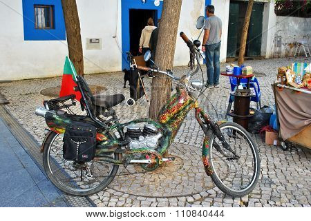 Marley Davidson motor bike in the old town of Albufeira in Portugal
