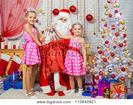 Girls Santa Claus Christmas Gifts Pulled Out Of The Bag