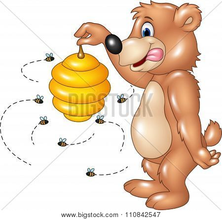 Cartoon funny bear holding Bee hive
