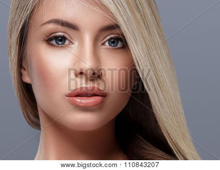 Beautiful Woman Portrait Face With Beautiful Blond Hair Studio On Gray Background