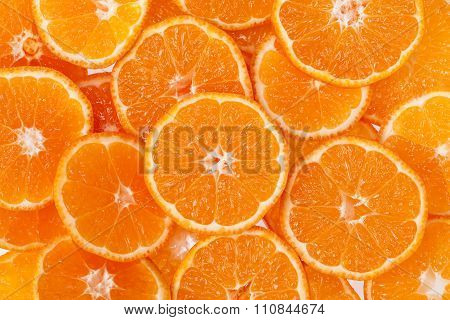 Background Of Slices Of Clementine Fruit.