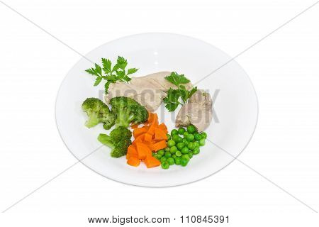 Boiled Meat With Vegetables On A White Plate