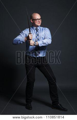 Businessman holding katana sword
