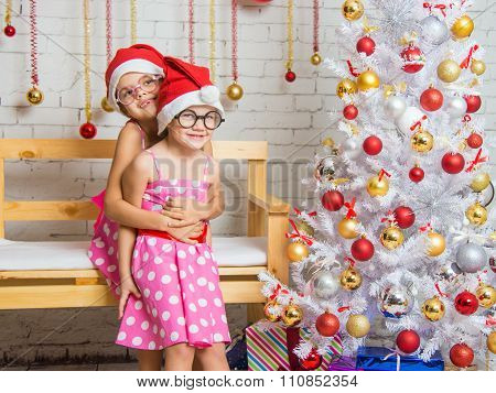 The Girl Hugged Her Sister Back In The New Years Home Decor