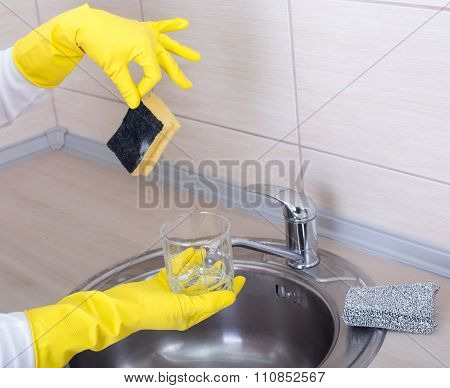 Woman Washing Dishes Wih Dirty Sponge