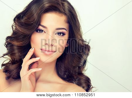 Beautiful girl light brown hair with  elegant hairstyle , hair wave