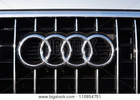 MALAGA, SPAIN - DECEMBER 2, 2015: AUDI car logo in the front grid. Audi is a German automobile manufacturer that designs, engineers, produces, markets and distributes luxury automobiles.