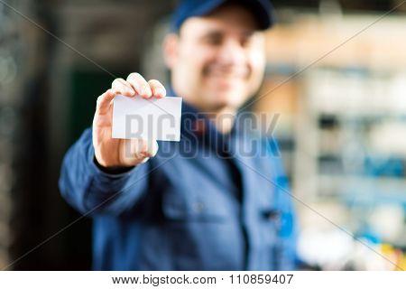 Mechanic showing a blank card