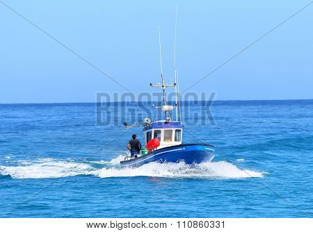 SAINT-PAUL, REUNION ISLAND, FRANCE - NOVEMBER 11, 2015: Patrol boat near Reunion coast watching and catching sharks.  It is the most dangerous place in the world for shark attacks.