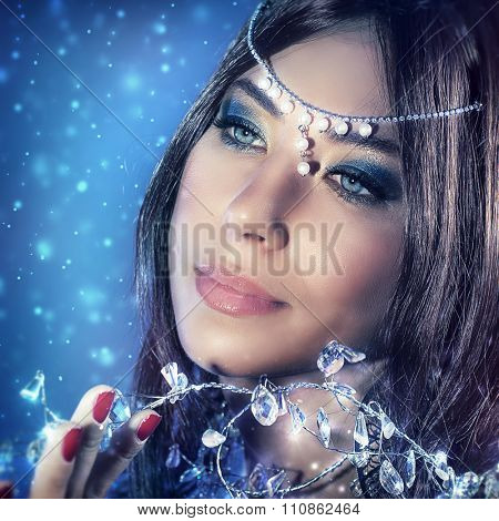 Portrait of beautiful princess with gorgeous makeup and luxury accessories, fabulous snow queen, glamor personage from wintertime fairytale