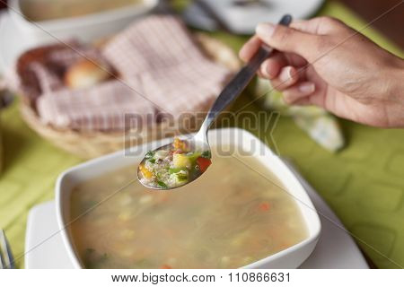 Young Woman Eating Hot And Healthy Soup