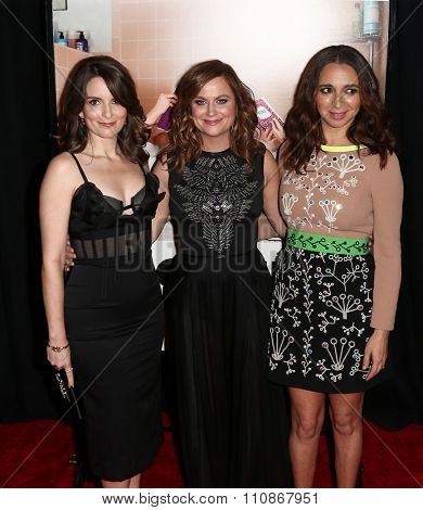 NEW YORK-DEC 8: (L-R) Actresses Tina Fay, Amy Poehler and Maya Rudolph attend the premiere of