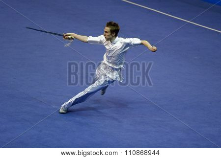 JAKARTA, INDONESIA: NOVEMBER 14, 2015: Peter Hlawaty from Slovakia performs the movements in the men's Jianshu event at the 13th World Wushu Championship 2015 held at Istora Senayan, Jakarta.
