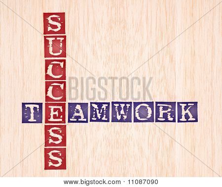 Success And Teamwork Word Stamped On Wooden Background