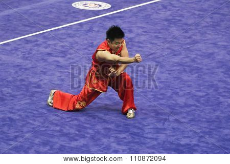 JAKARTA, INDONESIA: NOVEMBER 14, 2015: Friday Nnadi from Nigeria performs the movements in the men's Nanquan event at the 13th World Wushu Championship 2015 in Istora Senayan, Jakarta.