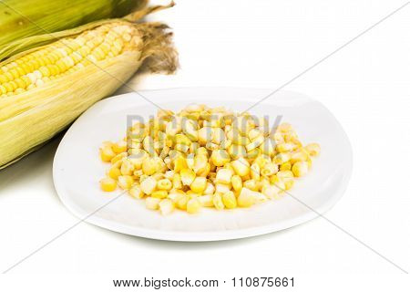 Fresh Maize Cob And Kernels On Plate Against White Background