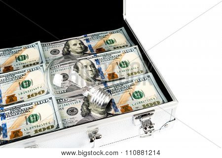 Suitcase of money with hundred dollar and light bulb for idea on white  background