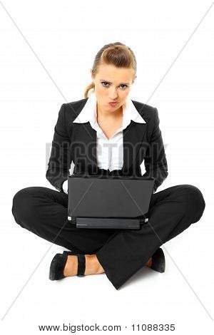 Laying on floor thoughtful modern business woman using laptop isolated on white