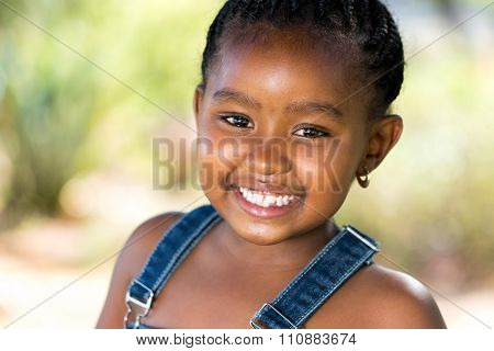 Smiling African Youngster Outdoors.