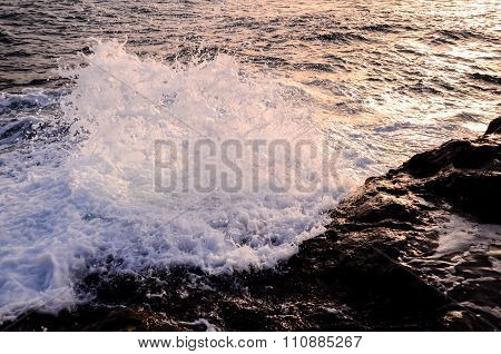 Strong Waves Crashing on the Volcanic Coast