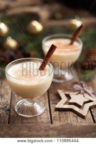 Eggnog christmas homemade winter egg, milk, rum, vanilla alcohol liqueur preparation recipe in two c