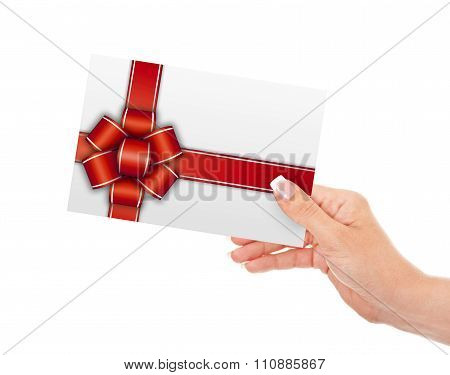Gift Card Holded By Hand Isolated Over White