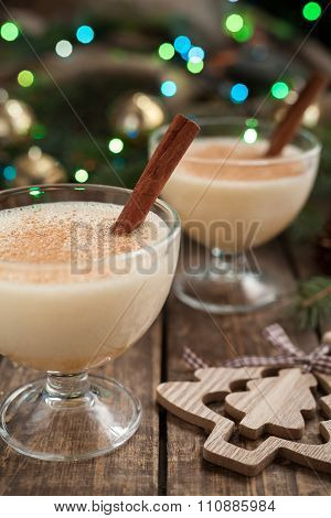 Eggnog traditional christmas egg, vanilla rum alcohol liqueur preparation recipe in two glass cups w