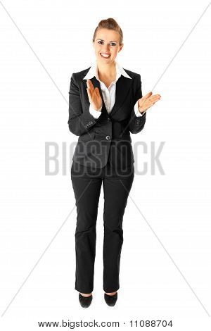 Full length portrait of applauding modern business woman isolated on white