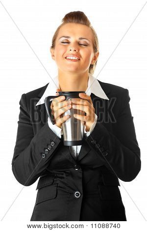 Modern business woman enjoying cup of coffee isolated on white