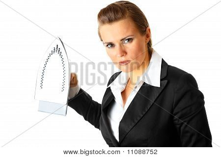 Angry modern business woman menacingly holding iron in hands isolated on white