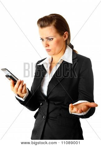 Modern business woman surprisedly looking at mobile phone isolated on white